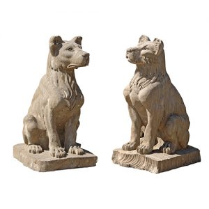 PAIR OF STONE SITTING DOGS